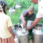 Ms. Kuppamal delivers the milk to her village people